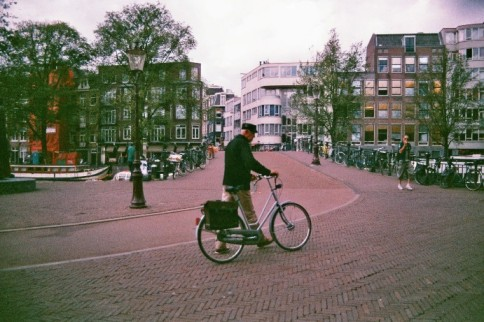 Amsterdam 35mm film photography Netherlands man men bike bridge channel city street photography