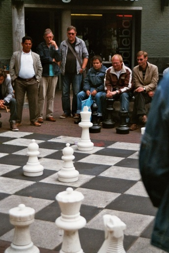 Amsterdam 35mm film photography street photography chess game people men man Rock cafe Netherlands