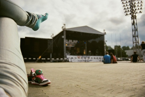 fujicolour superia 200 film 35mm stadium daugavas stadions rīga riga Reggae in Riga Sun Splash 2011 sky getting cosy feet legs summer fest festival  sun enjoying sweet summer weather sunlight stage nike hello kitty socks blue jeans legs chilling chill