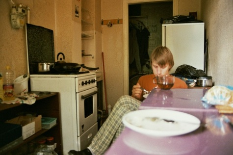 boy sitting home kitchen food eating getting ready breakfast fujicolour superia 200 film 35mm plates mood
