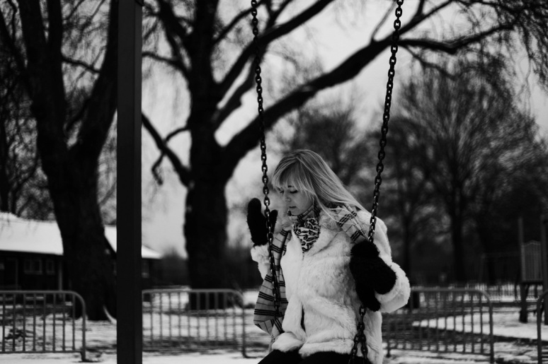 black and white, B&W, girl, model, shoot, photography, portrait, fashion shoot, coat, white , winter, casual, no colours , swings, playground, fun, thinking