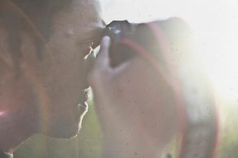 guy shooting light leak photography